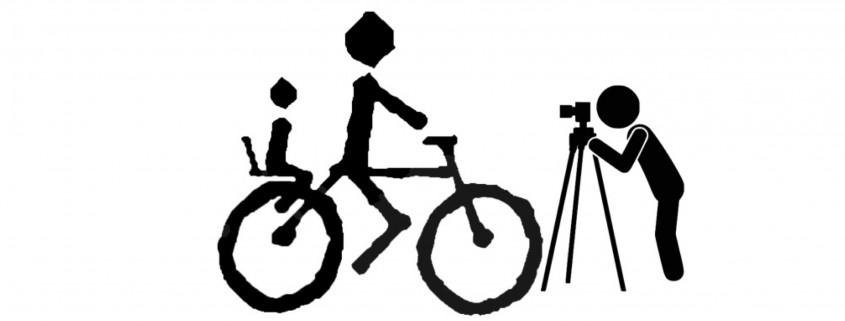 Imagen de figuras en negro de ciclista y fotógrafo