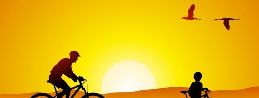 ciclistas-puesta-de-sol-anaranjada-siluetas-162010-1050x627